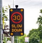 vehicle-activated solar powered signs
