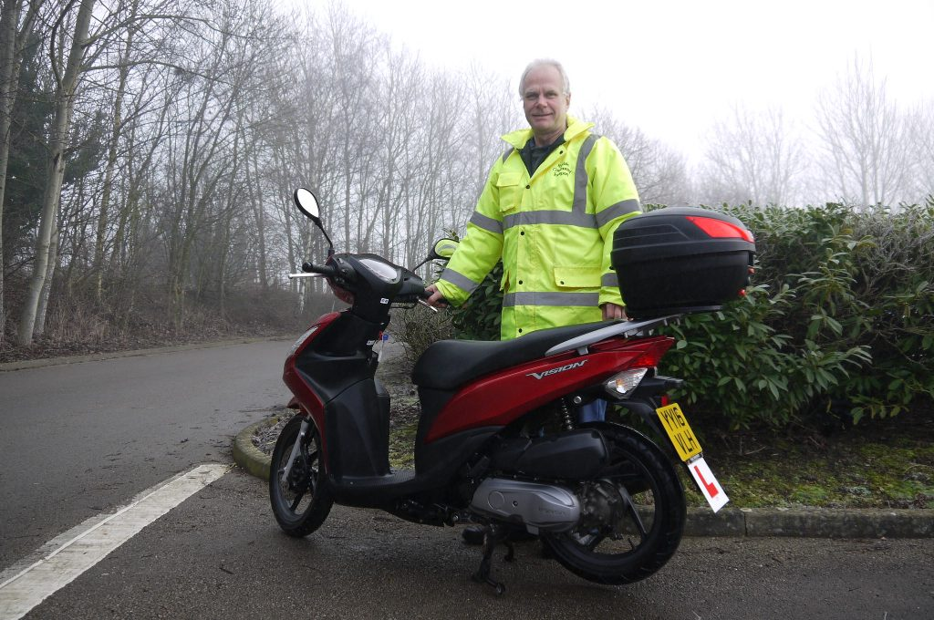 Mark Hall W2W Co-ordinator with one of the scheme's mopeds