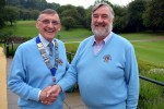 New President of the Ryedale Lions, David Warin, wearing the chain of office, with retiring President, Jim Ingham